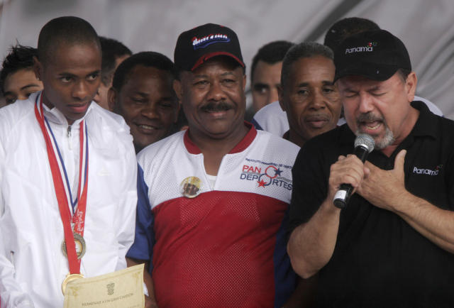 FILE - In this Aug. 21, 2008 file photo, boxing champion Eusebio Pedroza attends a celebration ceremony flanked by Olympic athlete Irving Saladino and Ruben Blades, in Panama City. The Panamanian ex-featherweight champ died on Friday, March 1, 2019. He was 62. (AP Photo/Arnulfo Franco, File)
