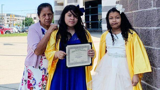 Alma Sofia Centeno Santiago's mother and 11-year-old daughter, center, at her fifth-grade graduation, along with one of the daughter's friends. (Photo: Jennifer Pacheco)