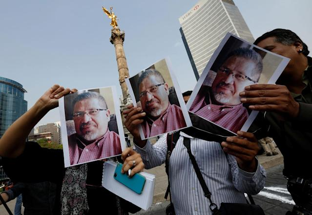 <p>Journalists and photographers hold up pictures of journalist Javier Valdez during a demonstration against his killing and for other journalists who were killed in Mexico, at the Angel of Independence monument in Mexico City, Mexico May on 16, 2017. (Henry Romero/Reuters) </p>