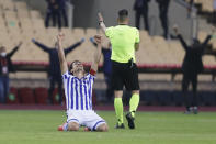 Real Sociedad's Mikel Oyarzabal, who scored the only goal celebrates winning the final of the 2020 Copa del Rey, or King's Cup, soccer match between Athletic Bilbao and Real Sociedad at Estadio de La Cartuja in Sevilla, Spain, Saturday April 3, 2021. The game is the rescheduled final of the 2019-2020 competition which was originally postponed due to the coronavirus pandemic. (AP Photo/Angel Fernandez)