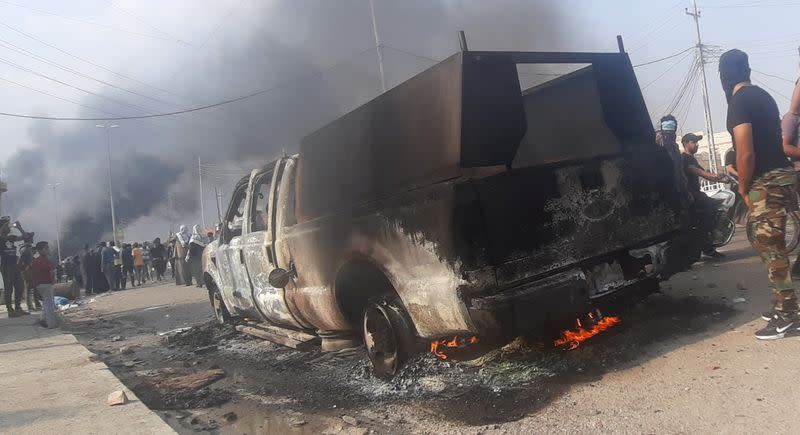 Burning vehicle of Iraqi security forces is seen after clashes with protesters during ongoing anti-government protests, in Nassiriya