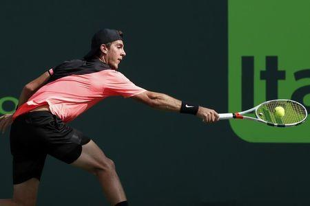 Mar 24, 2018; Key Biscayne, FL, USA; Thanasi Kokkinakis of Australia reaches for a backhand against Roger Federer of Switzerland (not pictured) on day five of the Miami Open at Tennis Center at Crandon Park. Mandatory Credit: Geoff Burke-USA TODAY Sports
