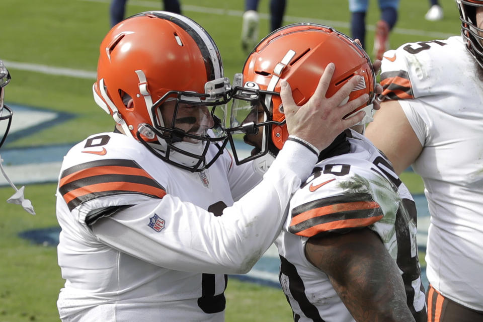 Cleveland Browns quarterback Baker Mayfield (6) congratulates wide receiver Jarvis Landry (80) after they teamed up for a touchdown pass against the Tennessee Titans in the first half of an NFL football game Sunday, Dec. 6, 2020, in Nashville, Tenn. (AP Photo/Ben Margot)