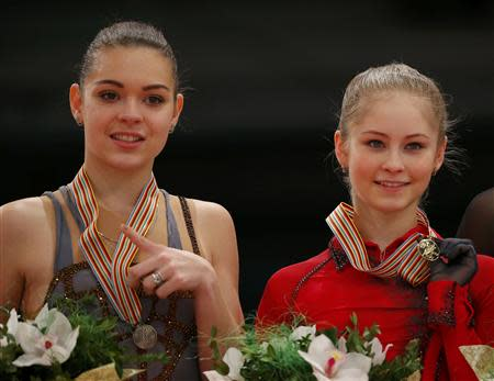 Gold medallist Julia Lipnitskaia of Russia and her compatriot silver medallist Adelina Sotnikova (L) pose during medal ceremony after the Ladies Free Skating event at the ISU European Figure Skating Championships in Budapest, January 17, 2014. REUTERS/Laszlo Balogh