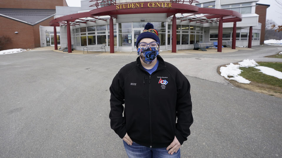 Student Lizzie Busby, 24, of Manchester, N.H., poses at New Hampshire Technical Institute, which is currently closed to students due to the COVID-19 virus outbreak, Thursday, Jan. 14, 2021, in Concord, N.H. With the pandemic causing major disruptions in education, employment, housing and more, young people who are no longer adolescents but not quite adults are struggling to find their footing. (AP Photo/Charles Krupa)