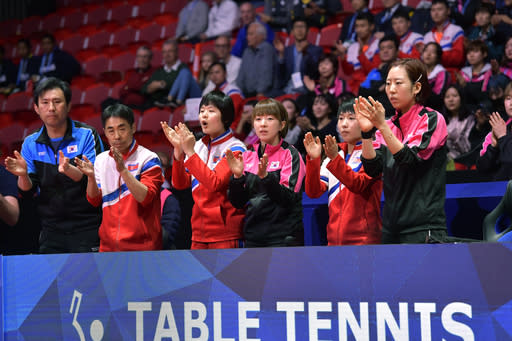 The combined Korea table tennis team applaud during the Women's semifinal match between Korea and Japan at the World Team Table Tennis Championship, in Halmstad, Sweden, Friday, May 4, 2018. North and South Korea have combined their women's teams at the table tennis world championships. (Jonas Ekstromer/TT News Agency via AP)