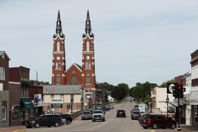 Traffic is seen on main street in Dyersville, Iowa, home to the Field of Dreams movie site, Friday, June 5, 2020. Major League Baseball is building another field a few hundred yards down a corn-lined path from the famous movie site in eastern Iowa but unlike the original, it's unclear whether teams will show up for a game this time as the league and its players struggle to agree on plans for a coronavirus-shortened season. (AP Photo/Charlie Neibergall)