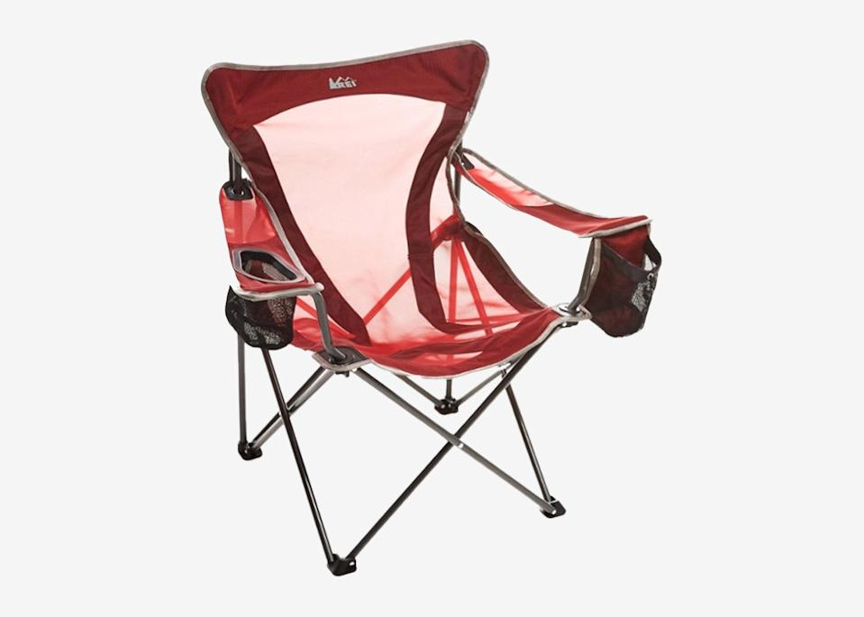 """<p>If you're not too tight on space, Quinn recommends adding a compact, foldable chair to slide into your trunk. You never know when you'll find yourself in need of a dry, comfortable chair on the fly—be it for extra seating at a roadside picnic table or to enjoy a secluded viewpoint at sunset. REI's Camp X chair is made of quick-dry mono-mesh and polyester material, and comes with a carrying case and two cup holders for impromptu lunch breaks.</p> <p><strong>Buy now:</strong> <a href=""""https://www.avantlink.com/click.php?tt=cl&merchant_id=e295c418-295a-447c-b265-734e25f82503&website_id=aed15f59-101c-4212-a1ba-e45530d719f3&url=https%3A%2F%2Fwww.rei.com%2Fproduct%2F847136%2Frei-co-op-camp-x-chair&ctc=roadtripessentials"""" rel=""""nofollow noopener"""" target=""""_blank"""" data-ylk=""""slk:$40, rei.com"""" class=""""link rapid-noclick-resp"""">$40, rei.com</a></p>"""