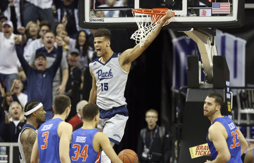 Nevada's Trey Porter (15) reacts after dunking during the second half of an NCAA college basketball game against Boise State in the Mountain West Conference men's tournament Thursday, March 14, 2019, in Las Vegas. (AP Photo/Isaac Brekken)