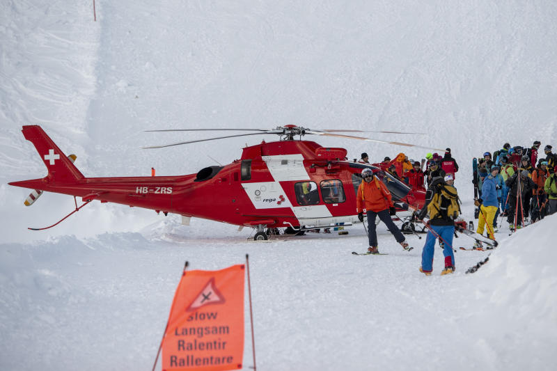 Rescue forces and helicopters still search for missed persons after an avalanche swept down a ski piste in the central town of Andermatt, canton Uri, Switzerland, Thursday, Dec. 26, 2019. Six people have been rescued, two of them with minor injuries but cantonal authorities fear that several other people may be buried. An extensive rescue operation is underway. (Urs Flueeler/Keystone via AP)