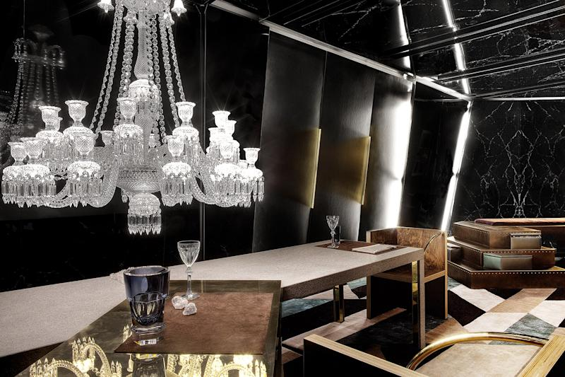 """A single, self-contained living space intended as an environment of """"endless melancholy"""" in reference to Tony Scott's 1983 film The Hunger. Showcased at Architectural Digest France's AD Intérieurs exhibition, all elements were custom apart from the Zenith chandeliers and Harcourt glasses by Baccarat."""