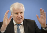 Horst Seehofer (CSU), Federal Minister of the Interior, for Construction and Home Affairs, presents the case figures of politically motivated crime for the year 2020 at the Federal Press Conference in Berlin, Germany, Tuesday, May 4, 2021. (Kay Nietfeld/dpa via AP)