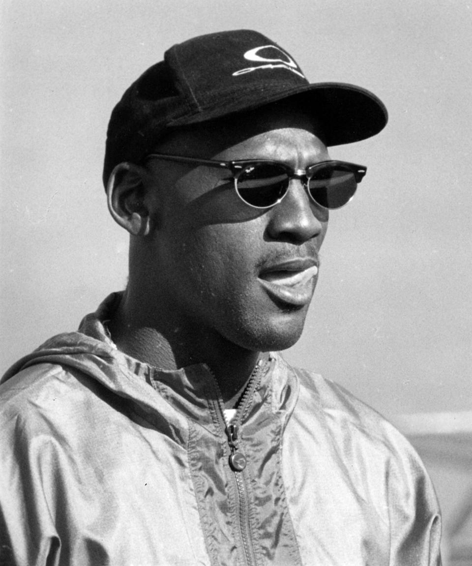 <p>Michael can be seen wearing a windbreaker and classic pair of Ray-Ban sunglasses in this suave black-and-white shot taken in 1994.</p>