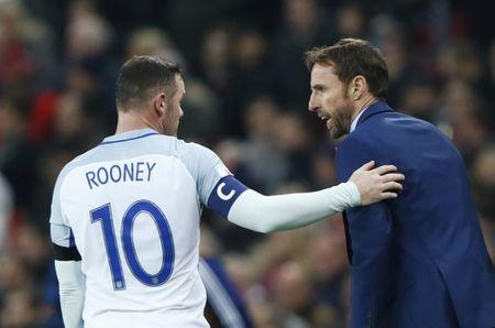 FILE PHOTO - Britain Football Soccer - England v Scotland - 2018 World Cup Qualifying European Zone - Group F - Wembley Stadium, London, England - 11/11/16 England interim manager Gareth Southgate speaks with Wayne Rooney  Reuters / Eddie Keogh