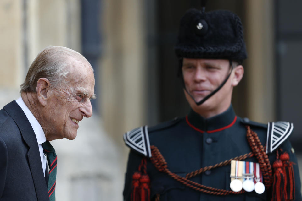 FILE - In this file photo dated Wednesday July 22, 2020, Britain's Prince Philip, The Duke of Edinburgh, at Windsor Castle for a ceremony for the transfer of the Colonel-in-Chief of the Rifles from the Duke to Camilla Duchess of Cornwall, at Windsor Castle, England, marking the Duke's 67-years of support and service to The Rifles. When Elizabeth became queen at the age of 25 in 1952, Philip gave up his naval career and dedicated himself to supporting her and the monarchy. (Adrian Dennis/Pool File via AP)
