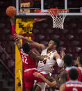 Minnesota forward Eric Curry (24) defends against Loyola Marymount guard Jalin Anderson (12) as Anderson goes to the net in the first half of an NCAA college basketball game Monday, Nov. 30, 2020, in Minneapolis. (Jeff Wheeler/Star Tribune via AP)