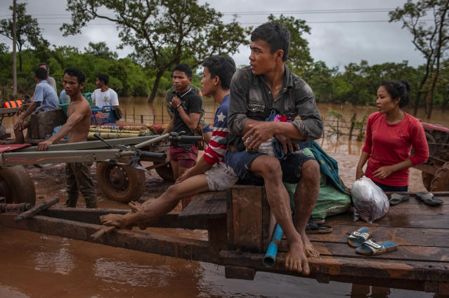 <p>Villagers evacuate to safer grounds after flash floods engulfed their villages the other night, on July 26, 2018 in Attepeu, southeastern Laos. (Photo: Jes Aznar/Getty Images) </p>