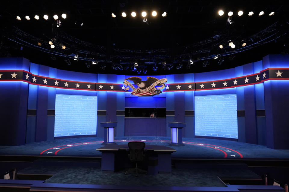 Lecterns for President Donald Trump and Democratic presidential candidate, former Vice President Joe Biden stand onstage as preparations take place for the second presidential debate at Belmont University, Thursday, Oct. 22, 2020, in Nashville, Tenn. (AP Photo/Patrick Semansky)