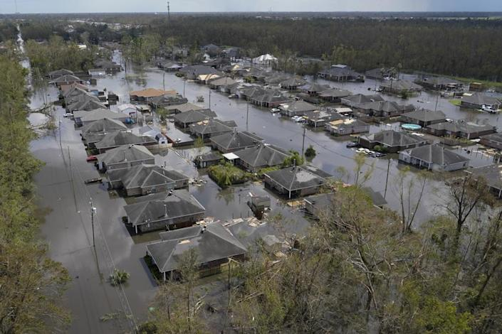 Homes are flooded in the aftermath of Hurricane Ida in LaPlace, La., Tuesday, Aug. 31, 2021. (AP Photo/Gerald Herbert)