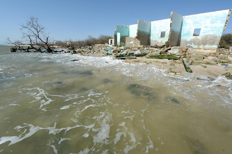 The ruins of houses destroyed by the rise of the sea level on May 7, 2013 in the village of Doun Baba Dièye, near Saint-Louis, northern Senegal (AFP Photo/Seyllou)