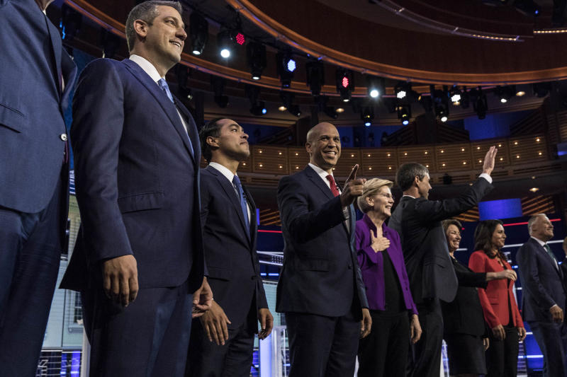 Democratic presidential candidates New York City Mayor Bill De Blasio (L-R), Rep. Tim Ryan (D-OH), former housing secretary Julian Castro, Sen. Cory Booker (D-NJ), Sen. Elizabeth Warren (D-MA), former Texas congressman Beto O'Rourke, Sen. Amy Klobuchar (D-MN), Rep. Tulsi Gabbard (D-HI), Washington Gov. Jay Inslee, take the stage during the first night of the Democratic presidential debate on June 26, 2019 in Miami, Florida. | Christopher Morris for TIME