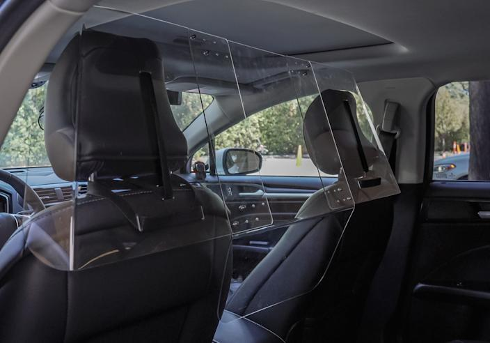 Here's what he plastic shields provided by Lyft look like in a car.