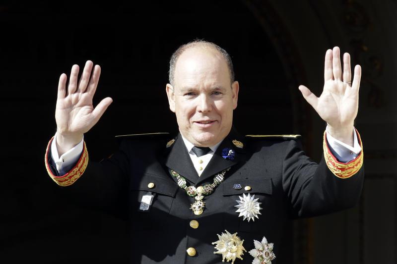 Prince Albert II of Monaco waves from the balcony of the Monaco Palace during the ceremonies marking the National Day in Monaco, Monday, Nov.19, 2018. (AP Photo/Claude Paris)