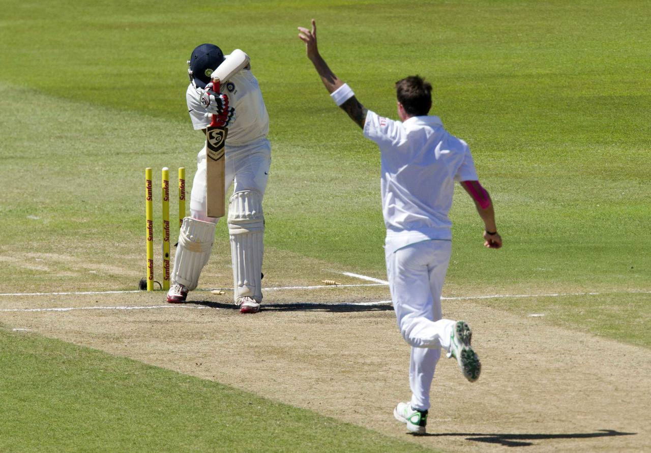 South Africa's Dale Steyn celebrates bowling India's Cheteshwar Pujara during the fifth day of the second cricket test match in Durban, December 30, 2013. REUTERS/Rogan Ward (SOUTH AFRICA - Tags: SPORT CRICKET)
