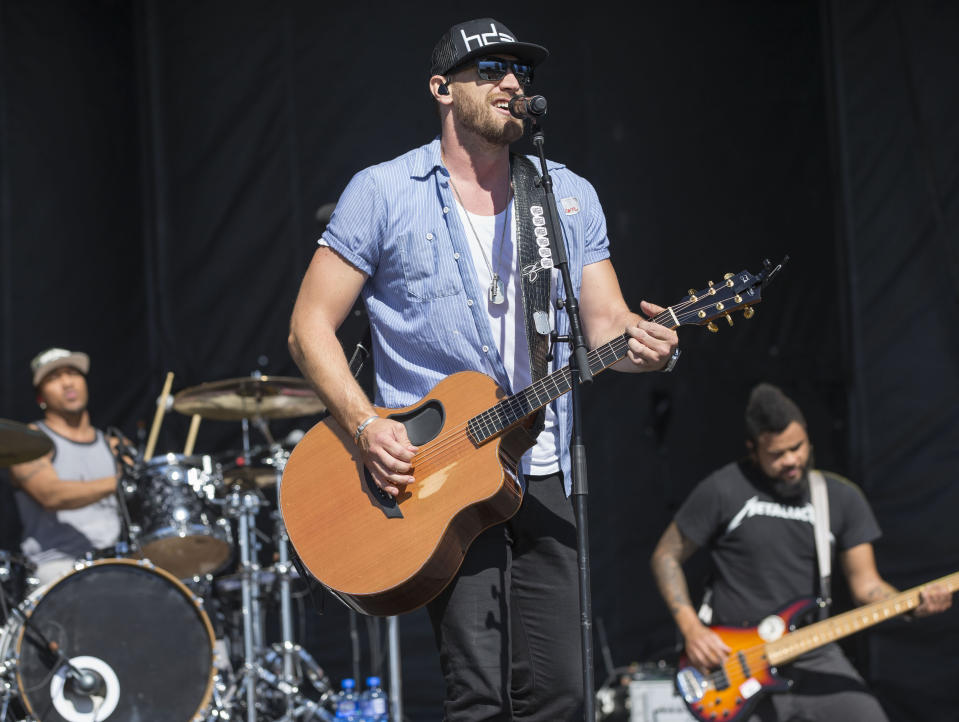 FILE - Chase Rice performs with his band at the 4th Annual ACM Party for a Cause Festival at the Las Vegas Festival Grounds in L:as Vegas, in this Sunday, April 3, 2016, file photo. Like many young football players growing up in North Carolina, Chase Rice had his sights set on the NFL. (Photo by Eric Jamison/Invision/AP, File)