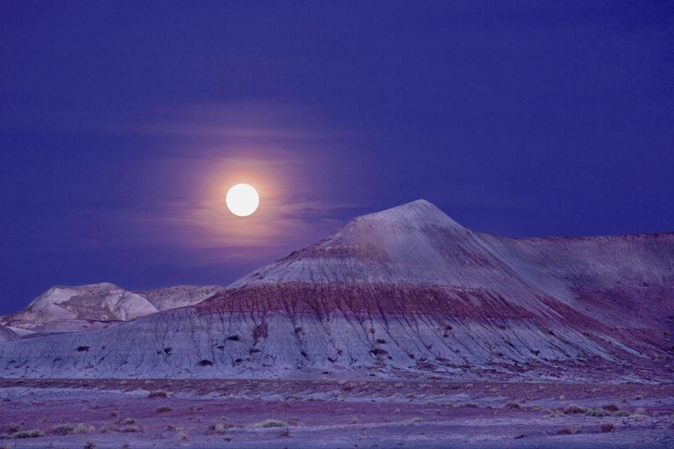 <p>The moon glows over the Teepees landforms at the Petrified Forest National Park, Arizona // July 30, 2008</p>