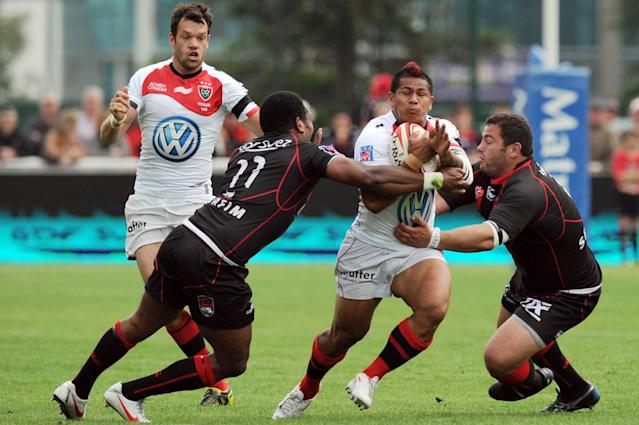 Toulon Samoan wing David Smith (C) is tackled by Lyon's French wing Remy Grosso (2ndL) and hooker Tony Testa (R) during the French Top 14 rugby union match Lyon vs. Toulon on May 12, 2012 in Lyon. AFP PHOTO PHILIPPE MERLEPHILIPPE MERLE/AFP/GettyImages