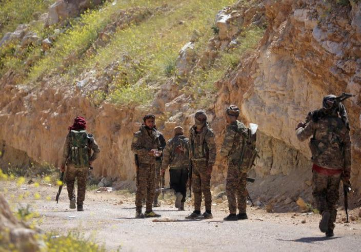 Fighters from SDF stand together in the village of Baghouz, Deir Al Zor province