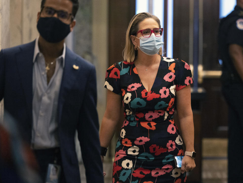 Sen. Kyrsten Sinema (D-AZ) walks to the Senate chambers at the U.S. Capitol on September 22, 2021 in Washington, DC. (Kevin Dietsch/Getty Images)