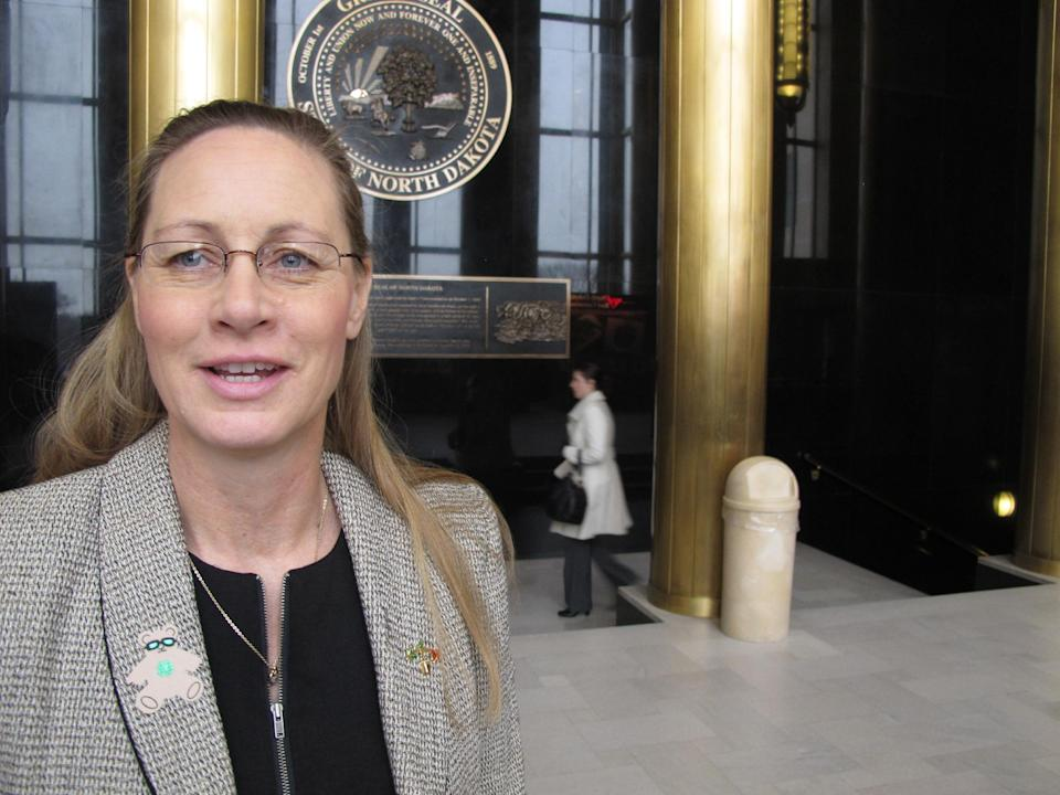 Rep. Bette Grande, R-Fargo, talks to reporters at the state Capitol in Bismarck, N.D., Friday, March 15, 2013. The North Dakota Senate approved two anti-abortion bills Friday, one banning abortions as early as six weeks into a pregnancy and another prohibiting the procedure because of genetic defects such as Down syndrome. North Dakota would be the only state in the United States to adopt either of those measures. Grande, a Republican from Fargo, introduced both bills. (AP Photo/James MacPherson)
