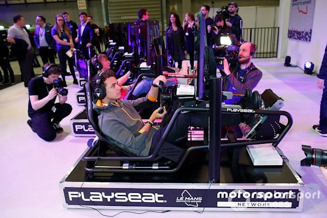 """Lando Norris, McLaren on the simulator at the Le Mans eSports Series stand <span class=""""copyright"""">Zak Mauger / Motorsport Images</span>"""