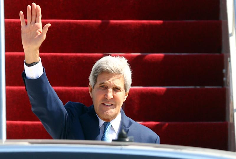 U.S. Secretary of State John Kerry waves as he disembarks from the plane upon his arrival at Bali's international airport in Denpasar, Indonesia, Friday, Oct. 4, 2013. President Barack Obama is canceling a trip to Asia to stay in Washington and push for an elusive funding bill to get the nation's business back up and running. (AP Photo/Firdia Lisnawati)