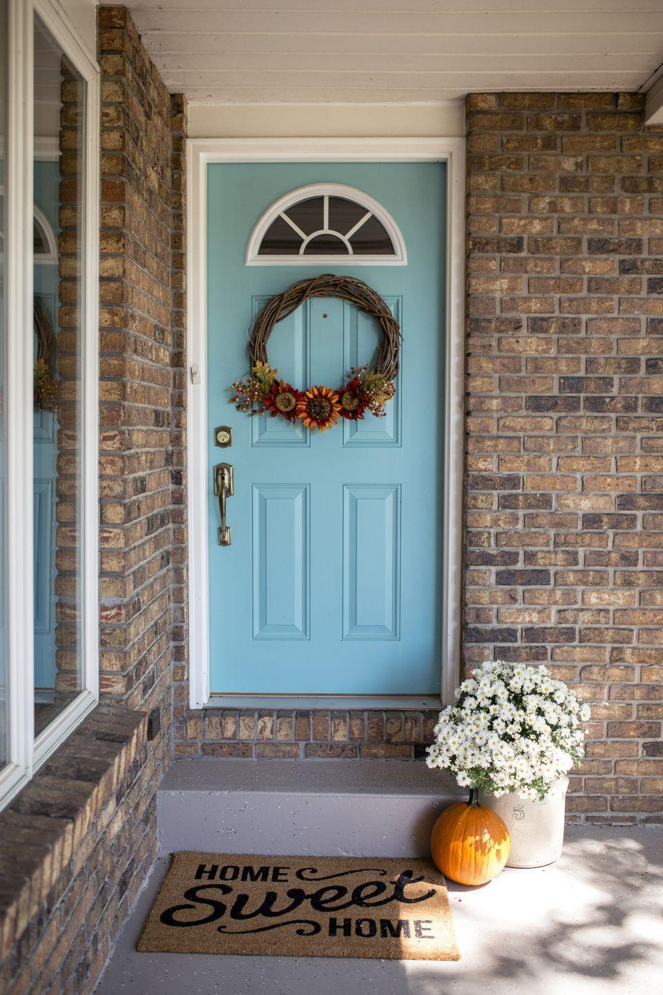 """<p>For a door that's already a conversation-starter, go for a floral wreath that works well past Halloween. Place a pumpkin on the floor next to pretty potted florals to round out your Halloween set-up.<br><br><a class=""""link rapid-noclick-resp"""" href=""""https://go.redirectingat.com?id=74968X1596630&url=https%3A%2F%2Fwww.wayfair.com%2Fdecor-pillows%2Fpdp%2Faugust-grove-decorative-20-fabric-wreath-aggr7160.html&sref=https%3A%2F%2Fwww.goodhousekeeping.com%2Fholidays%2Fhalloween-ideas%2Fg32948621%2Fhalloween-door-decorations%2F"""" rel=""""nofollow noopener"""" target=""""_blank"""" data-ylk=""""slk:SHOP DECORATIVE WREATH"""">SHOP DECORATIVE WREATH</a></p>"""