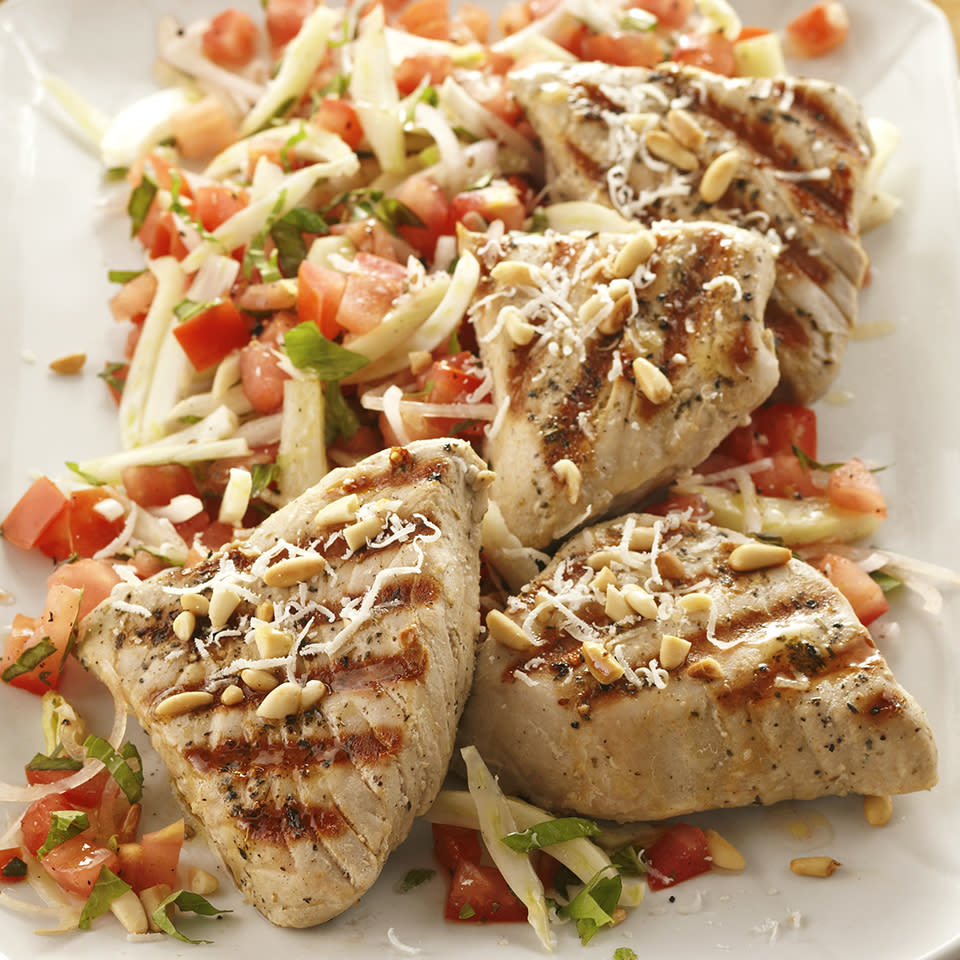 <p>A fresh marinated tomato and fennel salad serves as the perfect base for these grilled tuna steaks. This is a 20-minute meal that you'll be proud to serve to family and guests.</p>