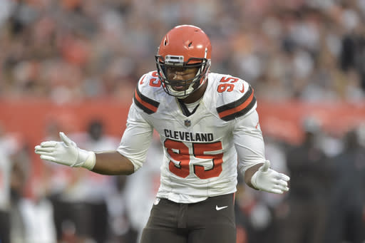 FILE - In this Aug. 17, 2018, file photo, Cleveland Browns defensive end Myles Garrett (95) reacts while standing on the field during an NFL football preseason game against the Buffalo Bills, in Cleveland. Garrett ran a photo of Steelers quarterback Ben Roethlisberger through a paper shredder for a video spoof during the offseason. On Sunday, Cleveland's dynamic defensive end plans to get his hands on the real Big Ben in the season opener. (AP Photo/David Richard, File)