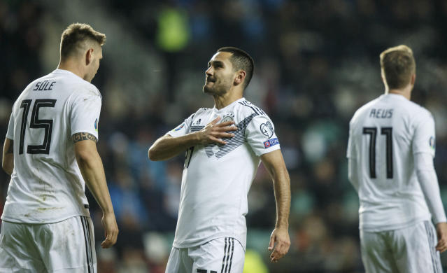 Germany's lkay Gundogan, centre, celebrates after scoring his side's first goal during the Euro 2020 group C qualifying soccer match between Estonia and Germany at the A. Le Coq Arena in Tallinn, Estonia, Sunday, Oct. 13, 2019. (AP Photo/Raul Mee)