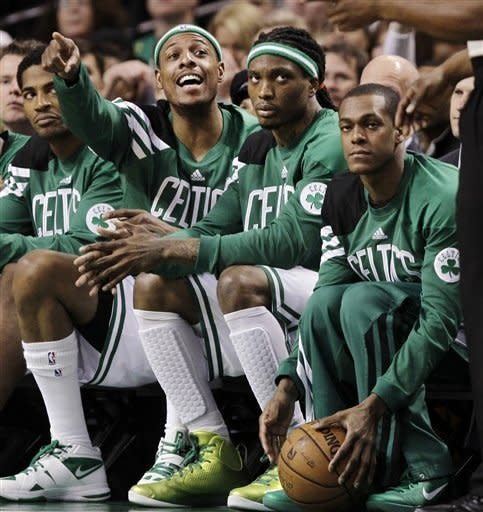 Boston Celtics forward Paul Pierce gestures to the referee from the bench as Marquis Daniels, center, and Rajon Rondo, right, watch during the second half against the Miami Heat in an NBA basketball game in Boston, Tuesday, April 24, 2012. The Celtics won 78-66. (AP Photo/Elise Amendola)