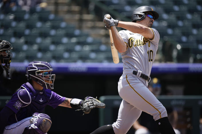 Pittsburgh Pirates' Bryan Reynolds connects for a solo home run off Colorado Rockies starting pitcher Jon Gray in the first inning of a baseball game Wednesday, June 30, 2021, in Denver. (AP Photo/David Zalubowski)
