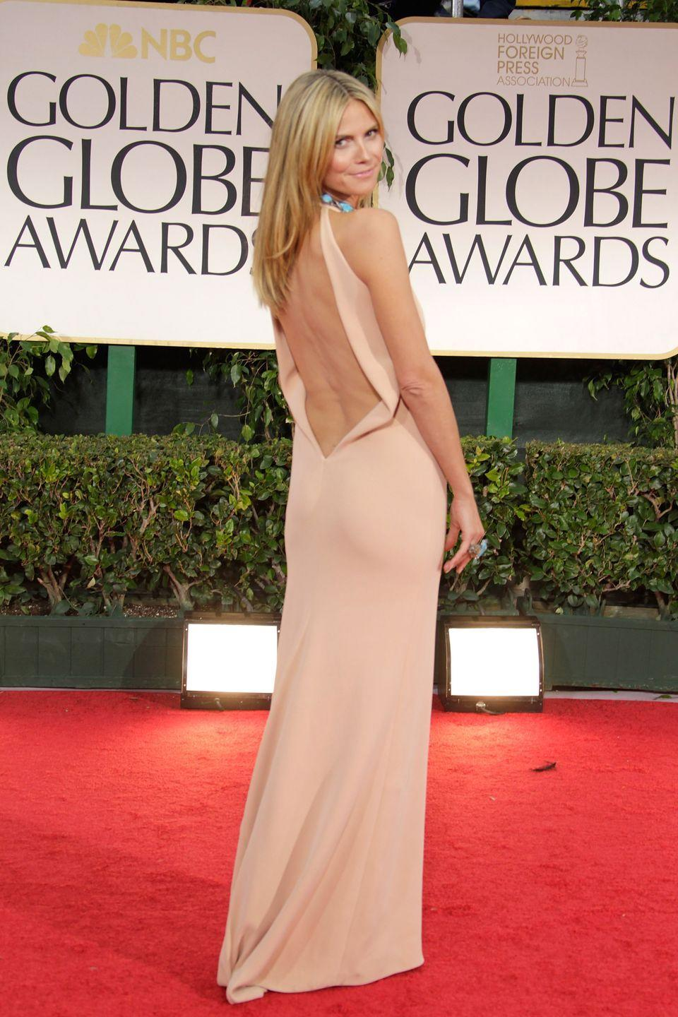<p>The model slipped into a down-to-there beige backless gown by Calvin Klein in 2012.</p>