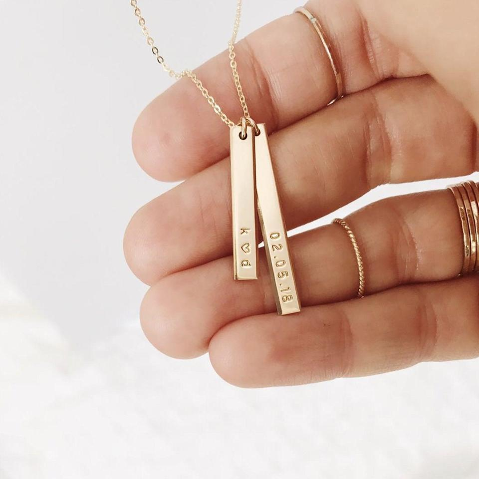"""<h3><a href=""""https://www.madebymary.com/collections/mama-collection/products/ray-bar-necklace"""" rel=""""nofollow noopener"""" target=""""_blank"""" data-ylk=""""slk:Made By Mary Ray Bar Necklace"""" class=""""link rapid-noclick-resp"""">Made By Mary Ray Bar Necklace</a></h3><br>This piece was designed so that mom can always keep her loved ones close to her heart. In addition to the necklace's 1"""" MAMA customizable bar, there's a second 1.25"""" bar which can be stamped with up to 10 characters of her liking. <br><br><strong>Made By Mary</strong> Ray Bar Necklace, $, available at <a href=""""https://go.skimresources.com/?id=30283X879131&url=https%3A%2F%2Fwww.madebymary.com%2Fcollections%2Fmama-collection%2Fproducts%2Fray-bar-necklace"""" rel=""""nofollow noopener"""" target=""""_blank"""" data-ylk=""""slk:Made By Mary"""" class=""""link rapid-noclick-resp"""">Made By Mary</a>"""