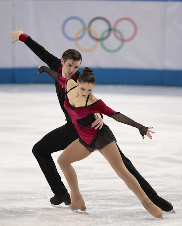 Stefania Berton and Ondrej Hotarek of Italy compete in the pairs free skate figure skating competition at the Iceberg Skating Palace during the 2014 Winter Olympics, Wednesday, Feb. 12, 2014, in Sochi, Russia. (AP Photo/Ivan Sekretarev)