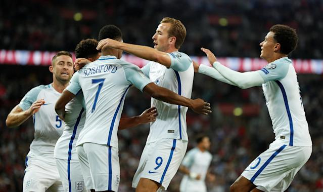 <p>Soccer Football – 2018 World Cup Qualifications – Europe – England vs Slovakia – London, Britain – September 4, 2017 England's Marcus Rashford celebrates scoring their second goal with team mates Action Images via Reuters/John Sibley </p>