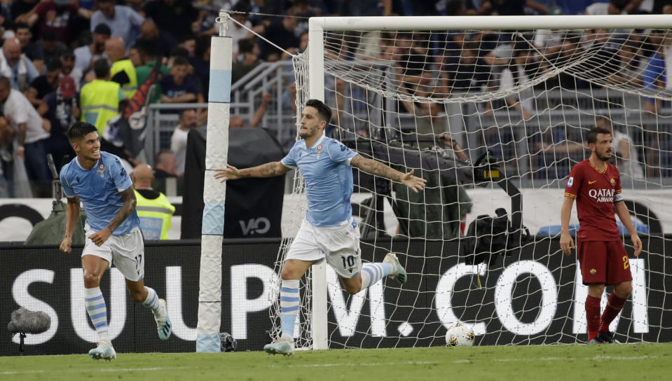 Lazio's Luis Alberto celebrates after scoring during a Serie A soccer match between Lazio and Roma, at the Rome Olympic stadium, Sunday, Sept. 1, 2019. (AP Photo/Alessandra Tarantino)