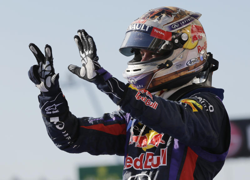 Red Bull driver Sebastian Vettel of Germany holds up eight fingers after winning his eighth race of the season following his win at the Formula One U.S. Grand Prix auto race at the Circuit of the Americas, Sunday, Nov. 17, 2013, in Austin, Texas. (AP Photo/David J. Phillip)