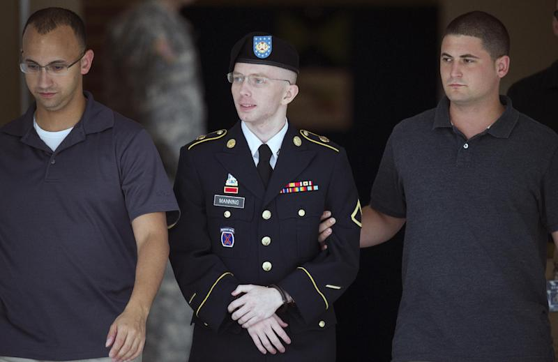 Army Pfc. Bradley Manning is escorted out of a courthouse at Fort Mead, Md, Thursday, July 25, 2013. Manning is charged with indirectly aiding the enemy by sending troves of classified material to WikiLeaks. He faces up to life in prison. (AP Photo/Cliff Owen))