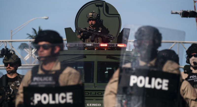 A Miami Police officer watches protestors from a armored vehicle during a rally in response to the recent death of George Floyd in Miami, Florida on May 31, 2020. (Photo: RICARDO ARDUENGO/AFP via Getty Images)